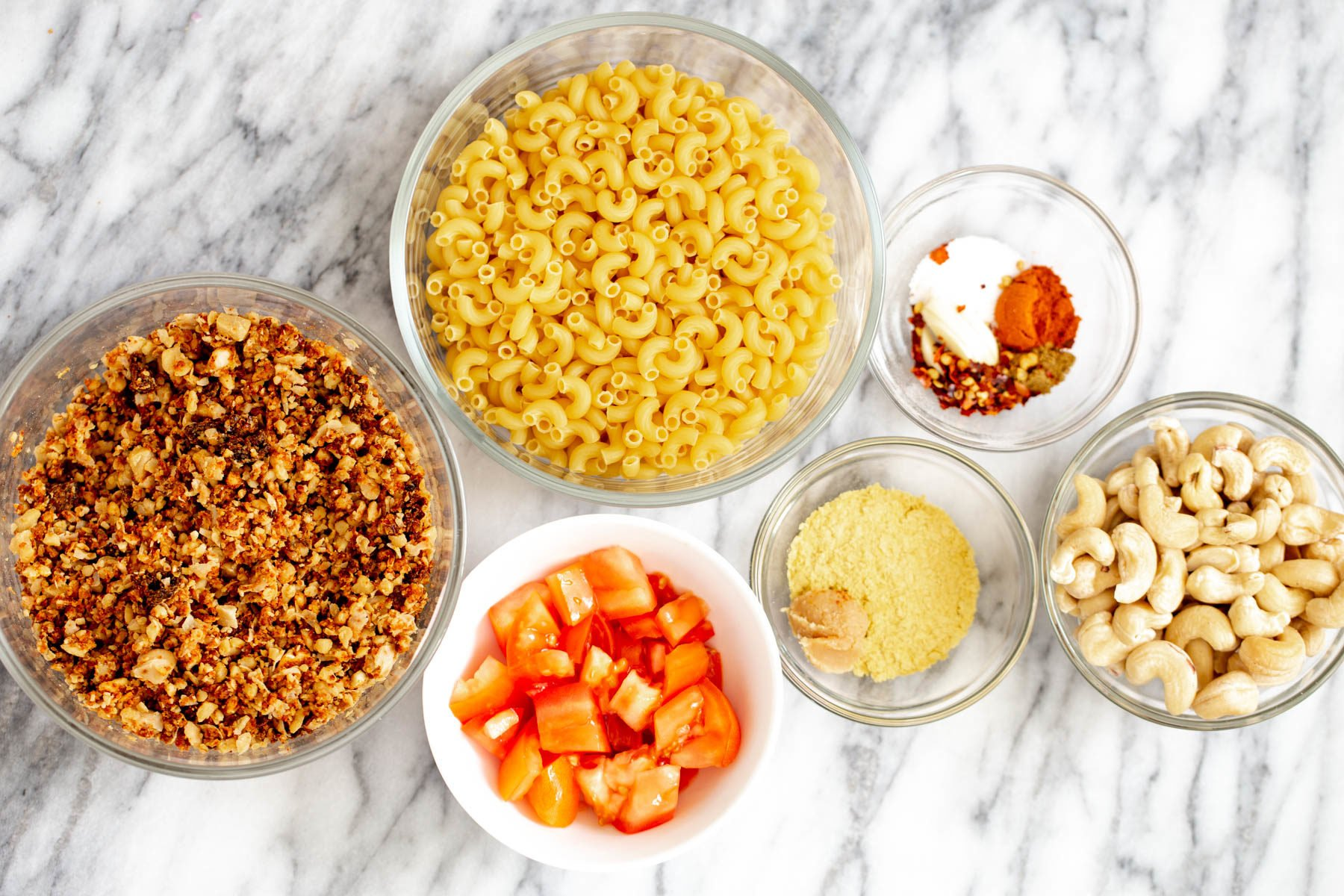 overhead shot of ingredients needed for making vegan mac and cheese taco bake