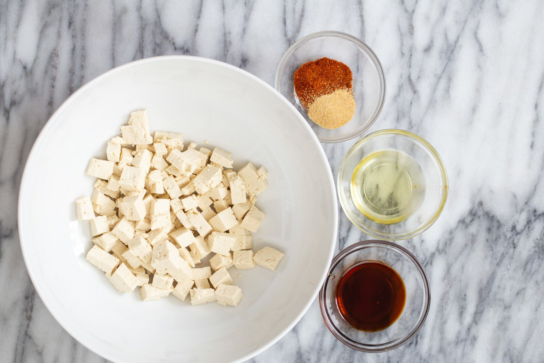 tofu cubes with condiments for making roasted crispy tofu as pasta topping