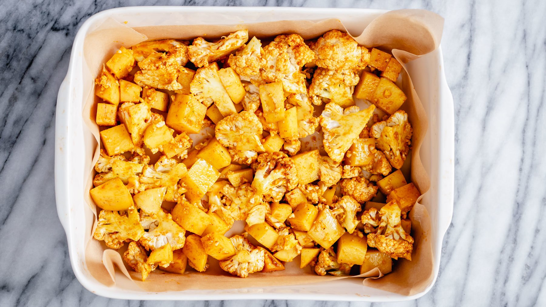 cauliflower and potato cubes in a casserole dish