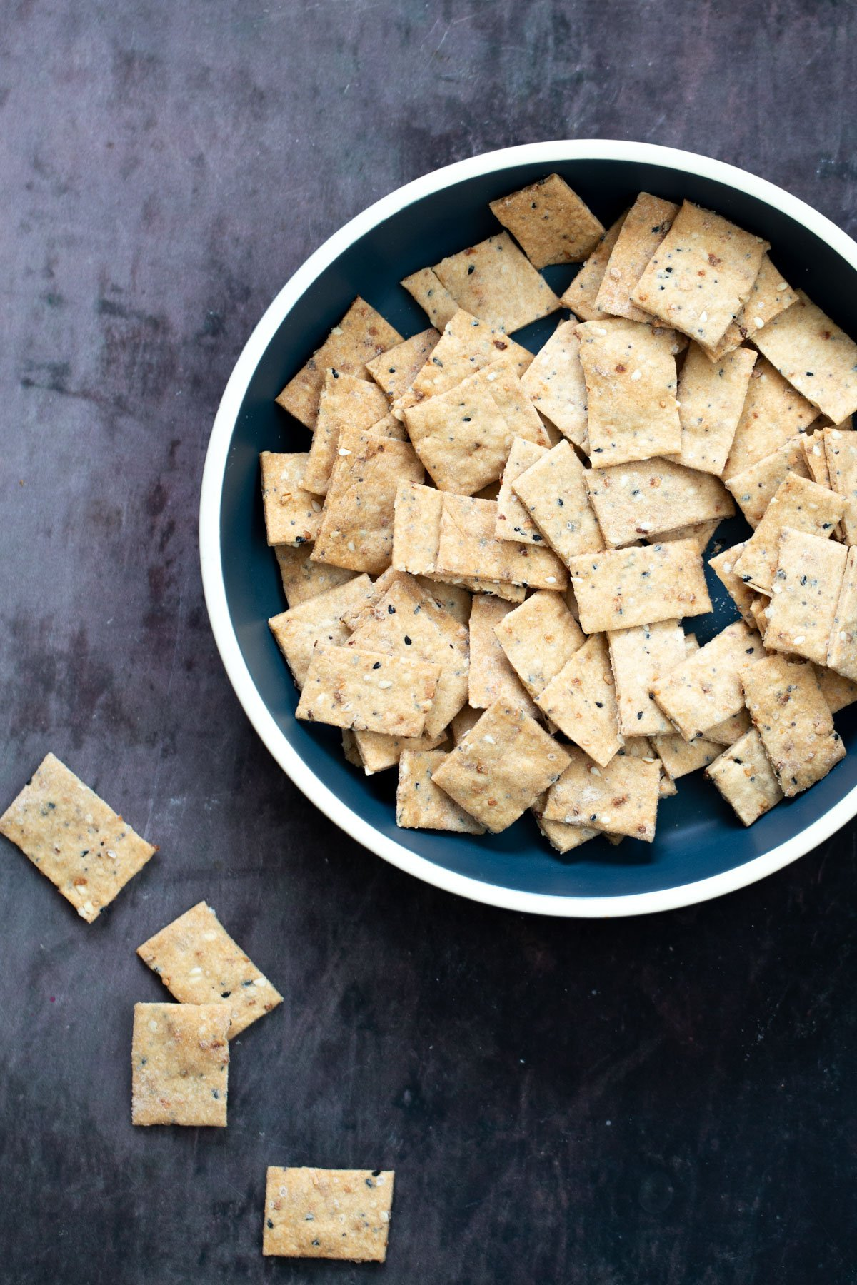 a bowl with vegan Everything But the Bagel Crackers
