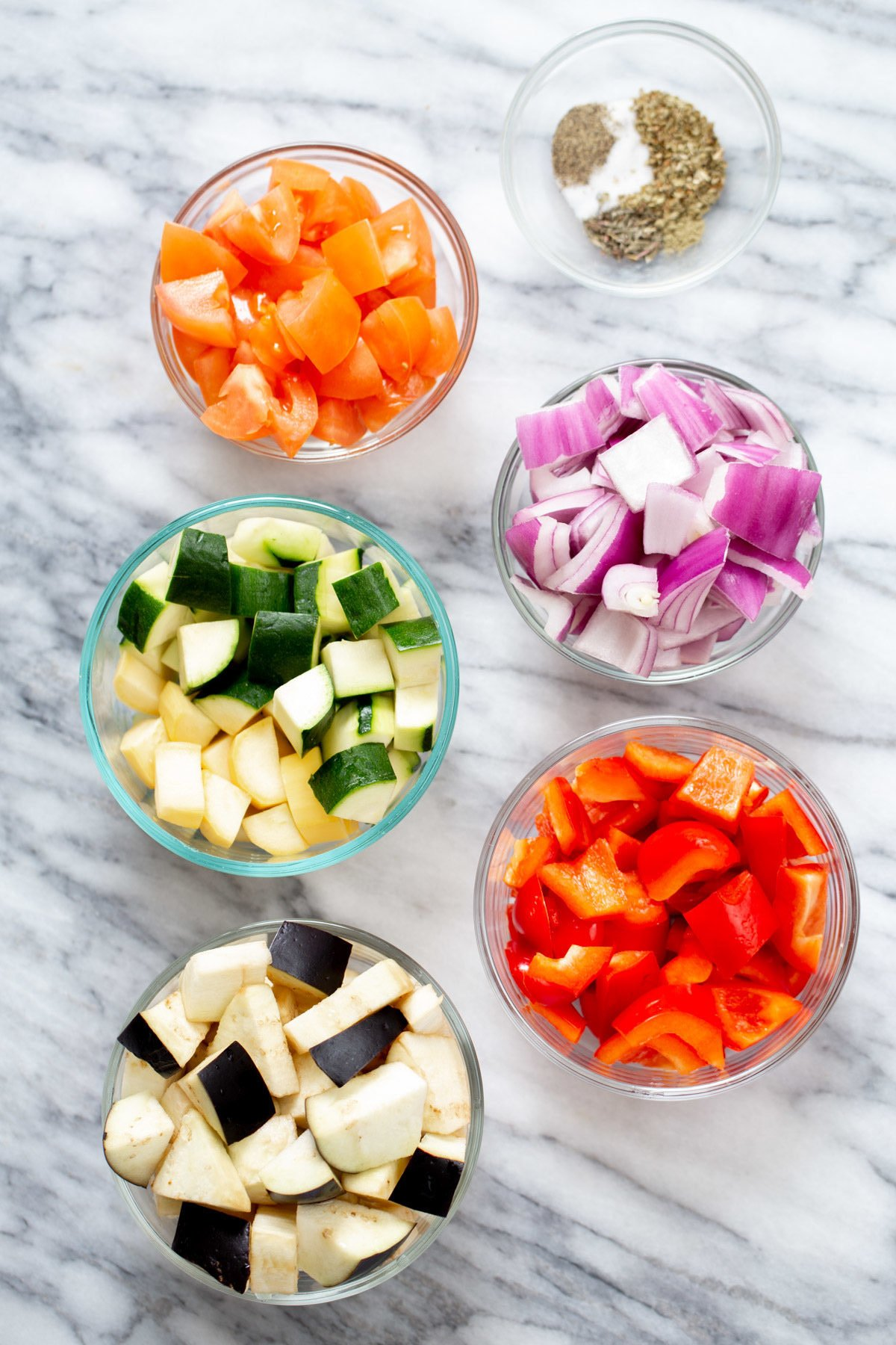 ingredients for baked ratatouille in glass bowls