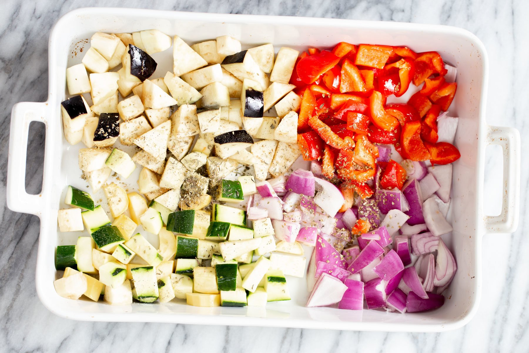 veggies for baked ratatouille in a casserole dish