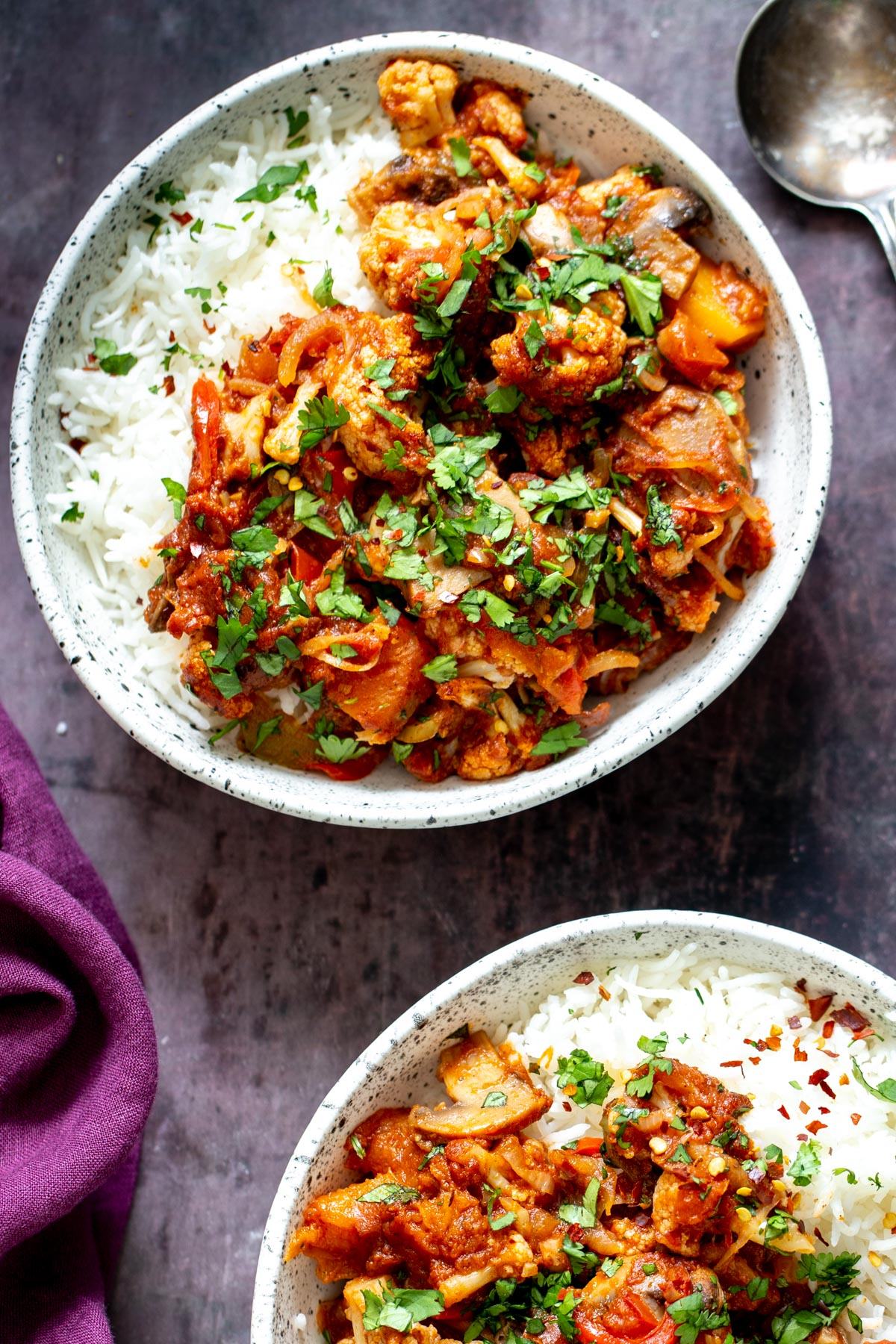 a bowl with rice topped with vegetable balti