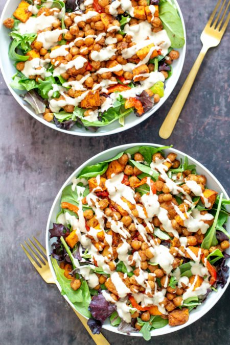 two bowls of sweet potato chickpea salad with tahini dressing