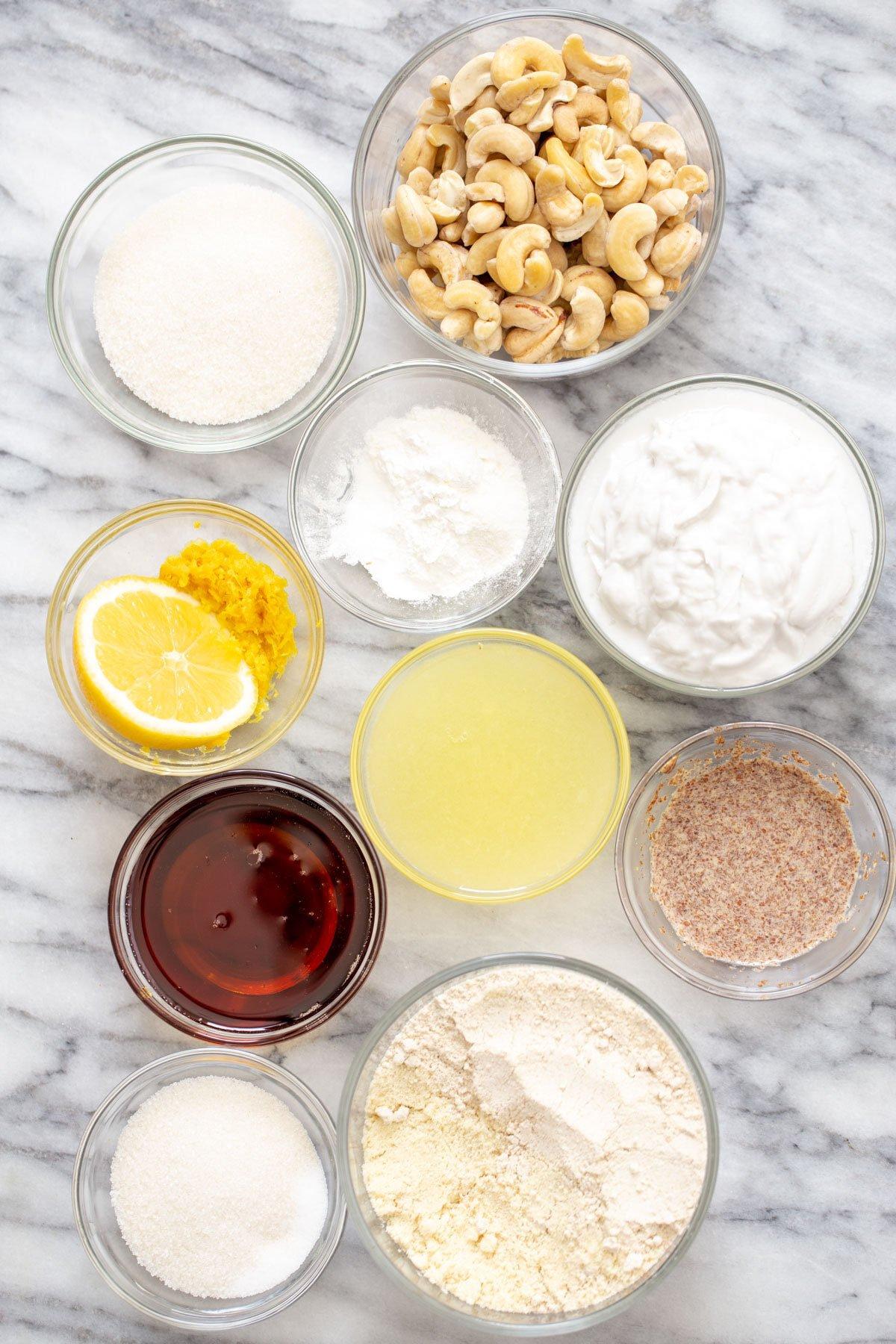 ingredients for vegan lemon bars on a marble counter