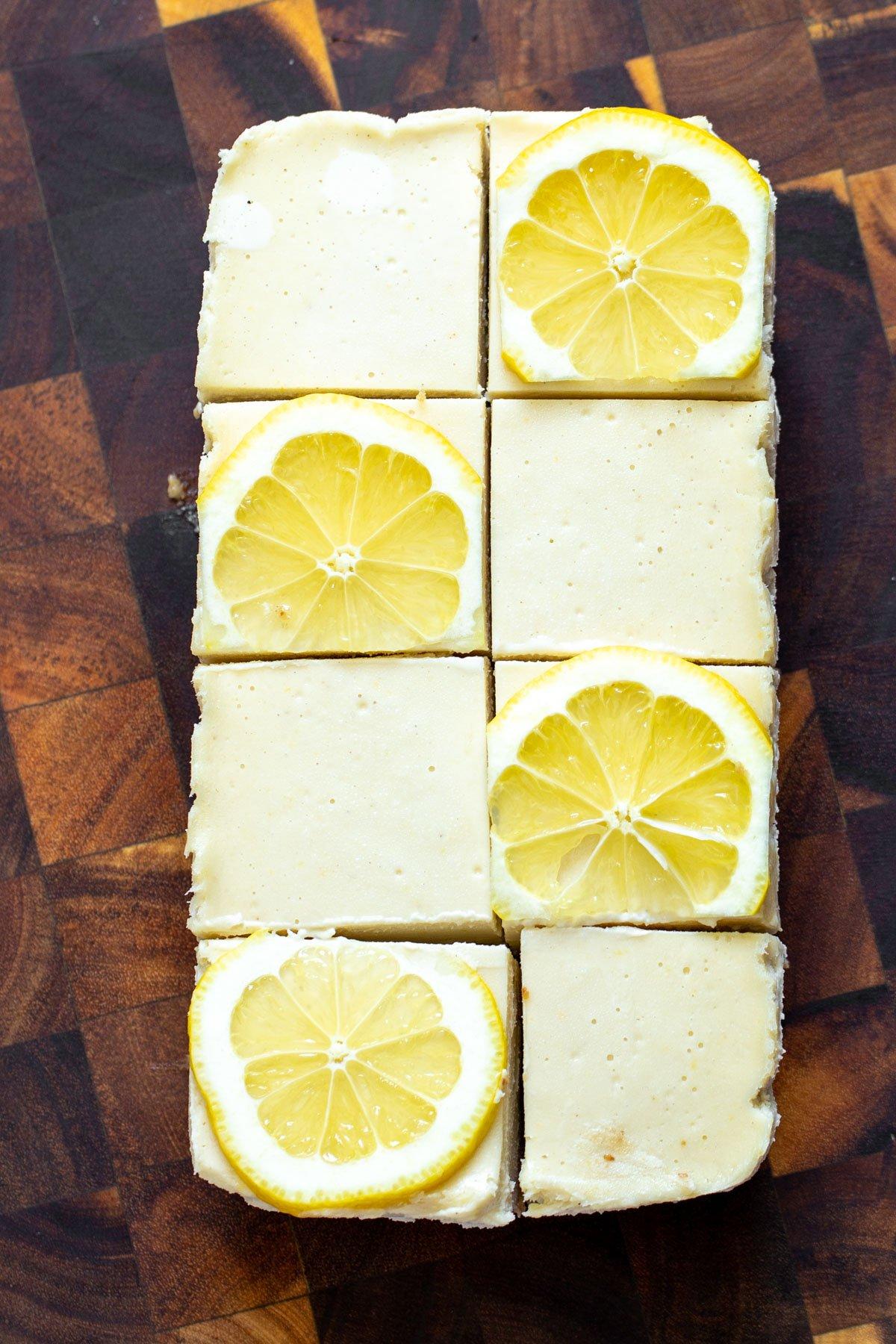 vegan lemon bars topped with fresh lemon slices