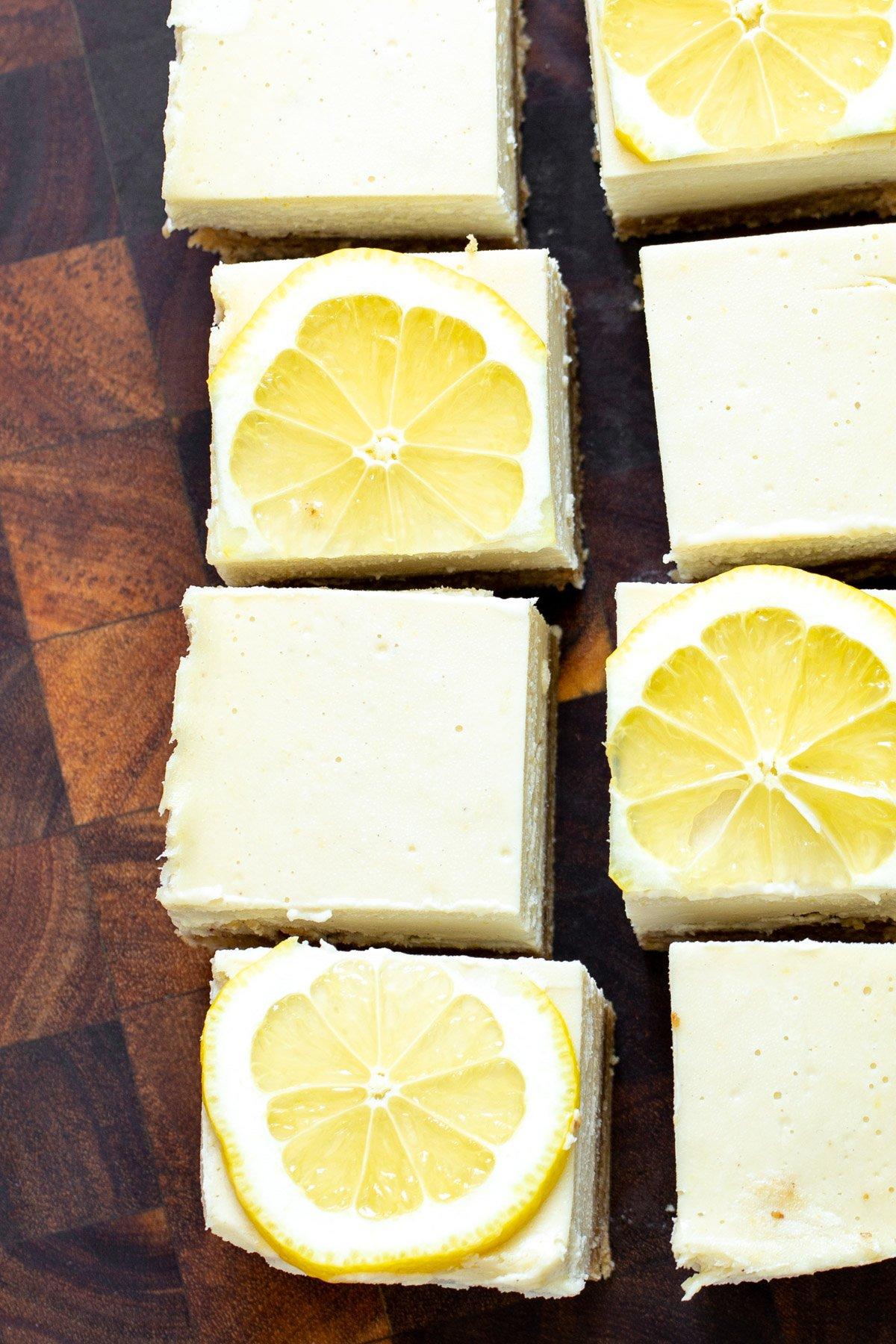 freshly cut vegan lemon bars topped with lemon slices