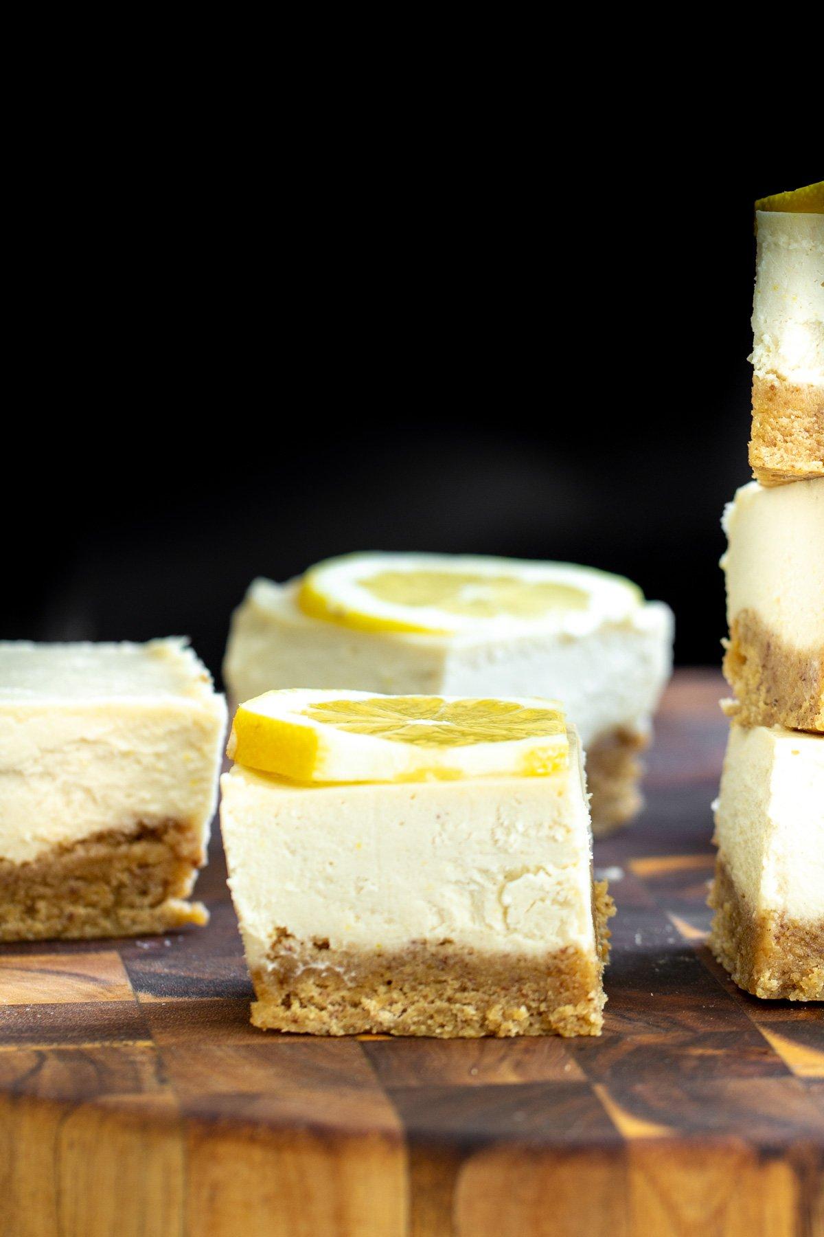 vegan lemon bars with glutenfree crust on a wooden chopping board