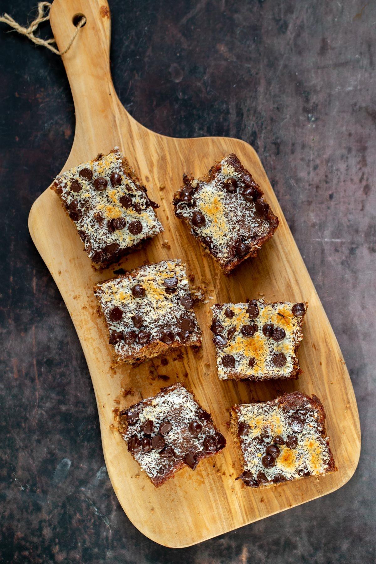 vegan oatmeal date caramel snack bars on a wooden board
