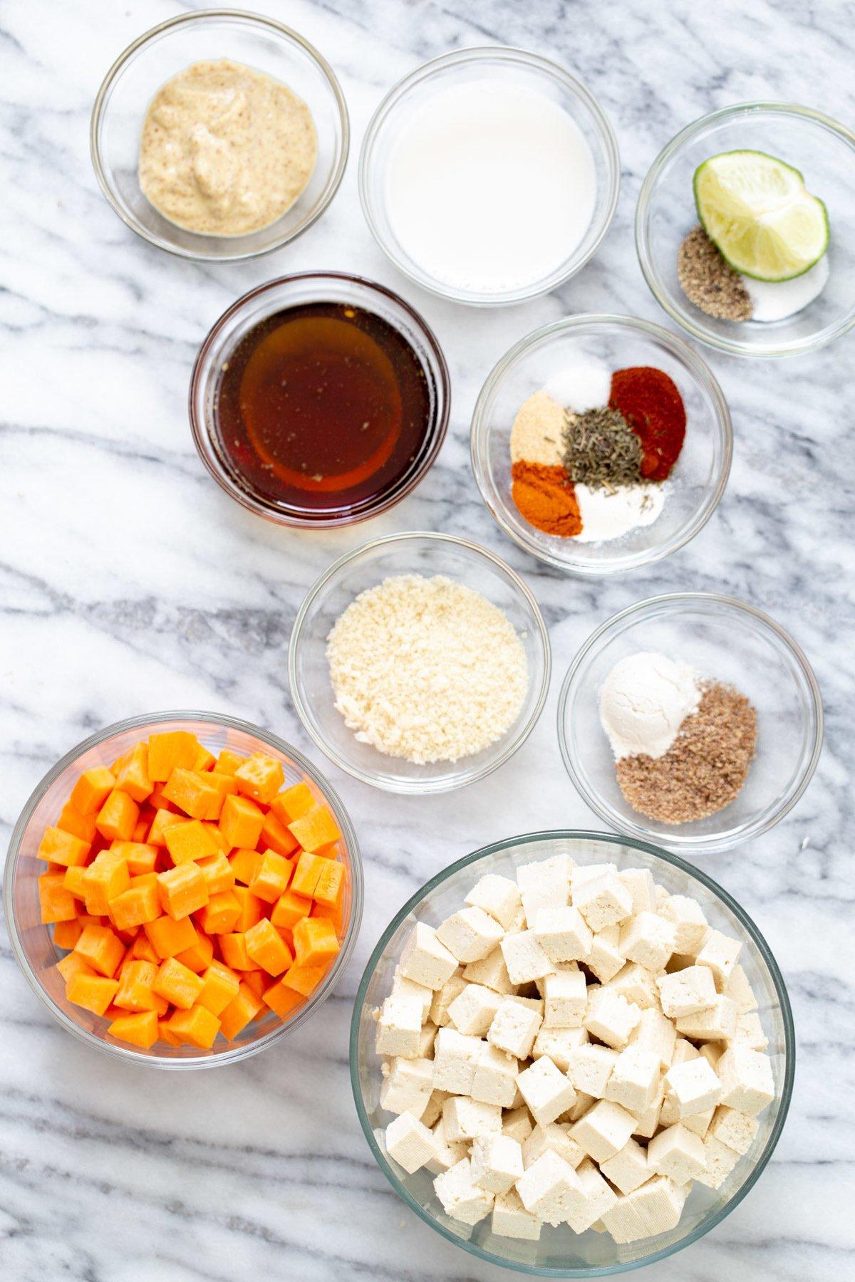 overhead shot of ingredients needed for sweet potato tofu bowls