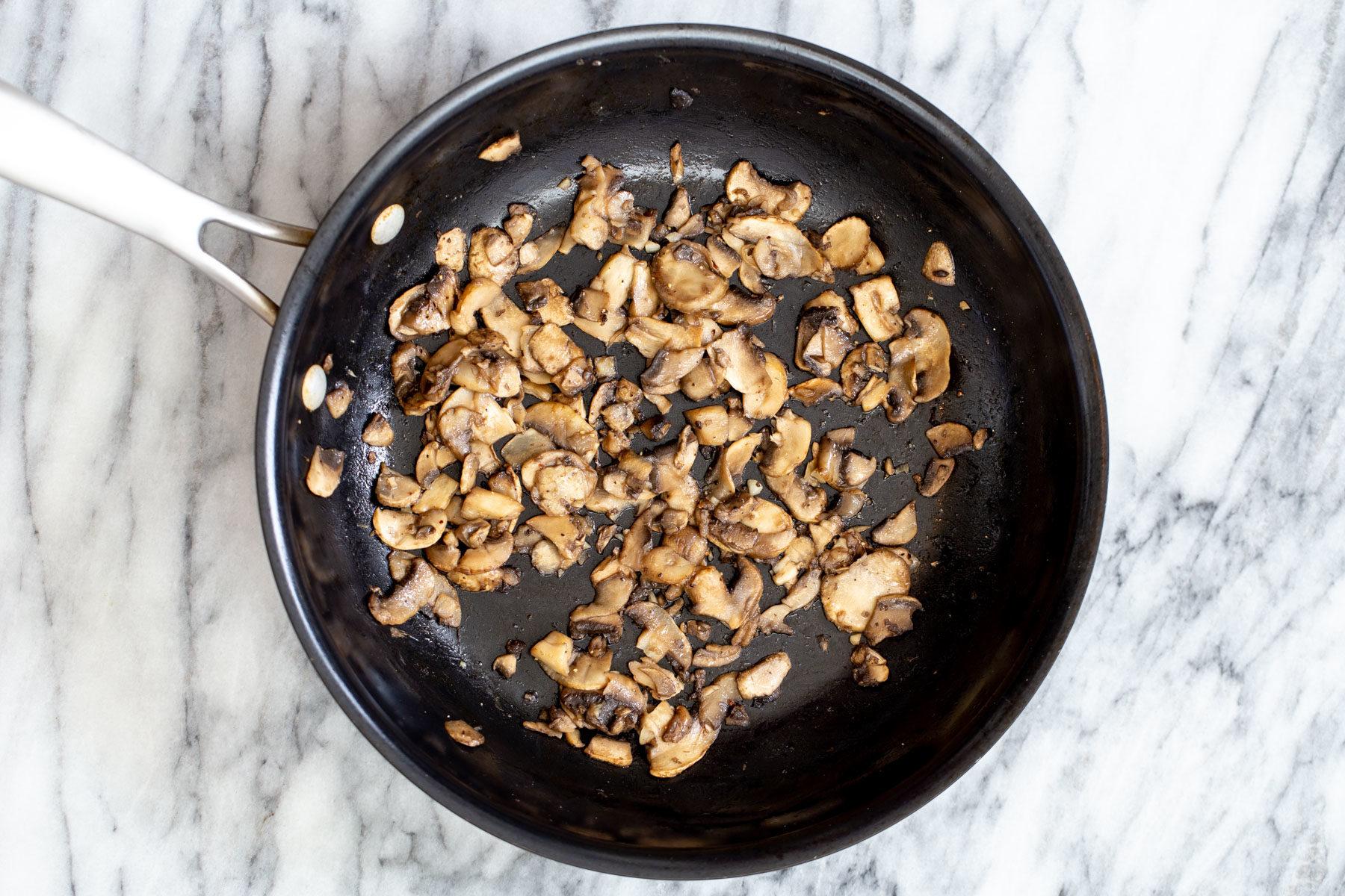 sauteed mushrooms in a frying pan
