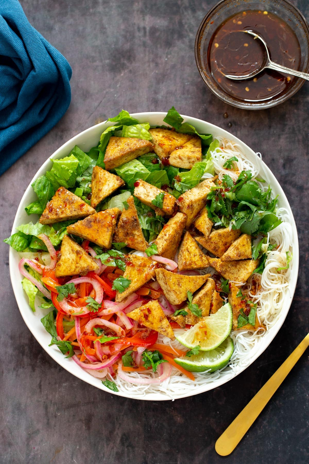 Vietnamese tofu noodle bowls drizzled with sweet spicy maple lime dressing