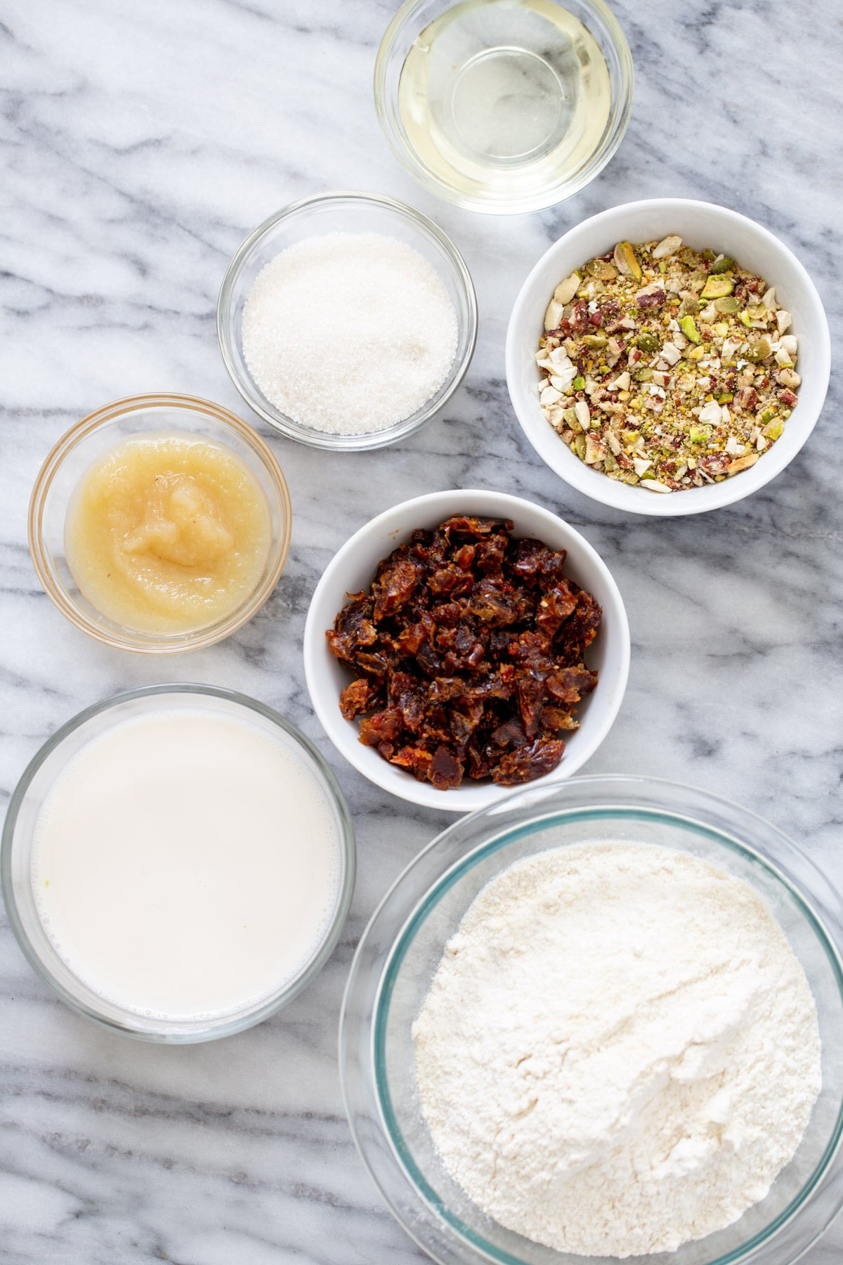 ingredients for vegan date nut cake on a marble countertop