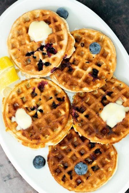 a plate of gluten-free lemon blueberry waffles