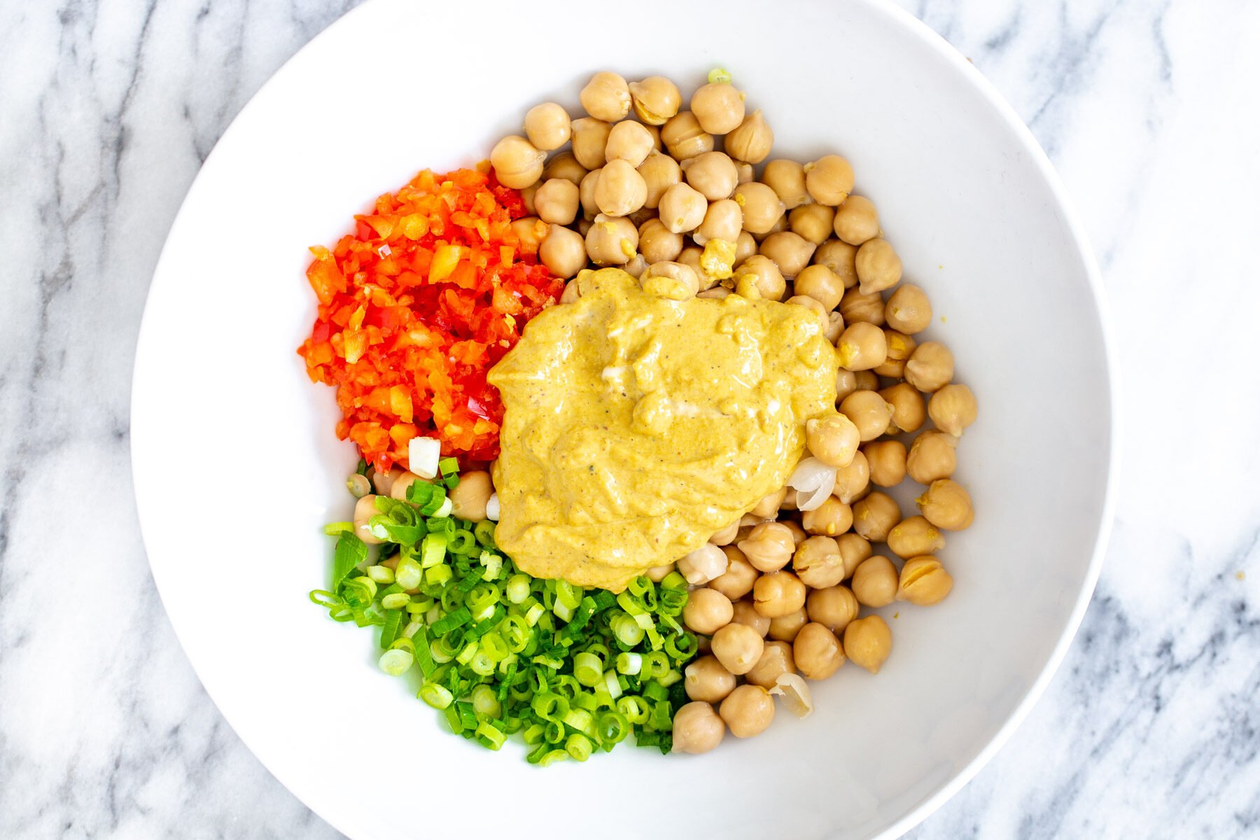 ingredients for vegan chickpea scramble in a white bowl