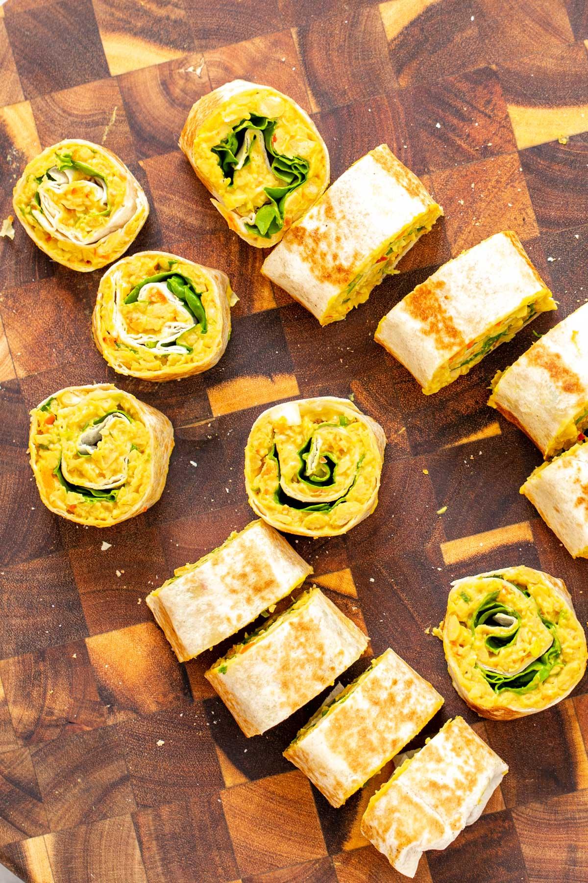 vegan chickpea scramble wraps being sliced into pinwheels