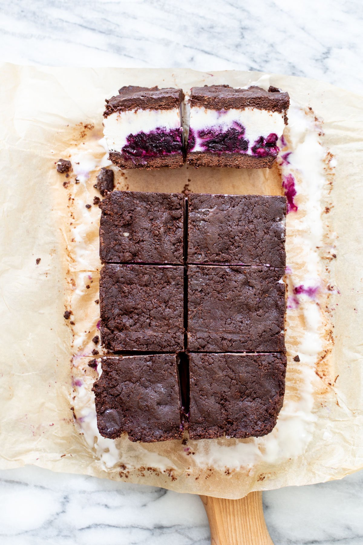vegan vanilla ice cream sandwiches being cut into squares