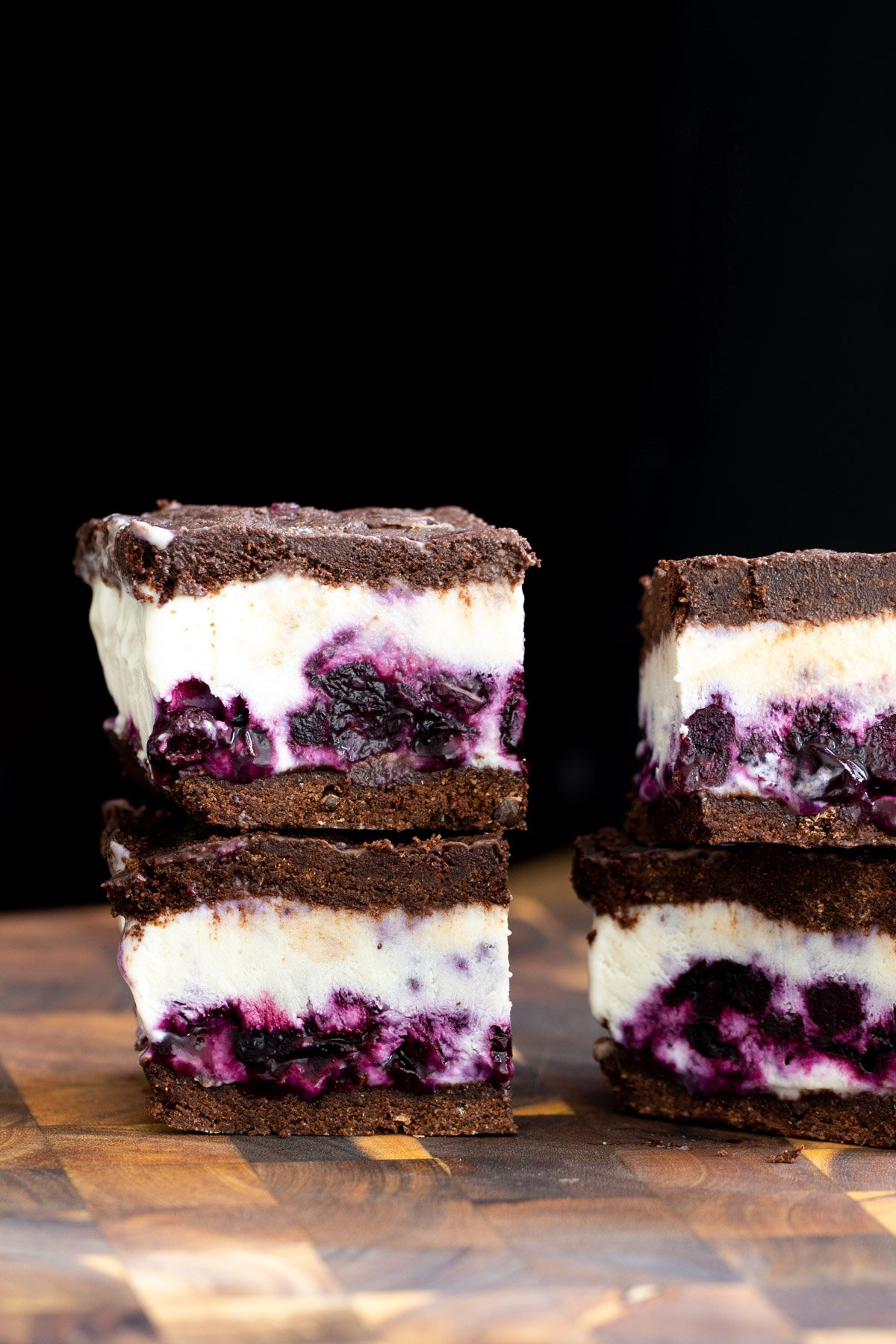 vegan vanilla blueberry swirl ice cream sandwiches on a chopping board