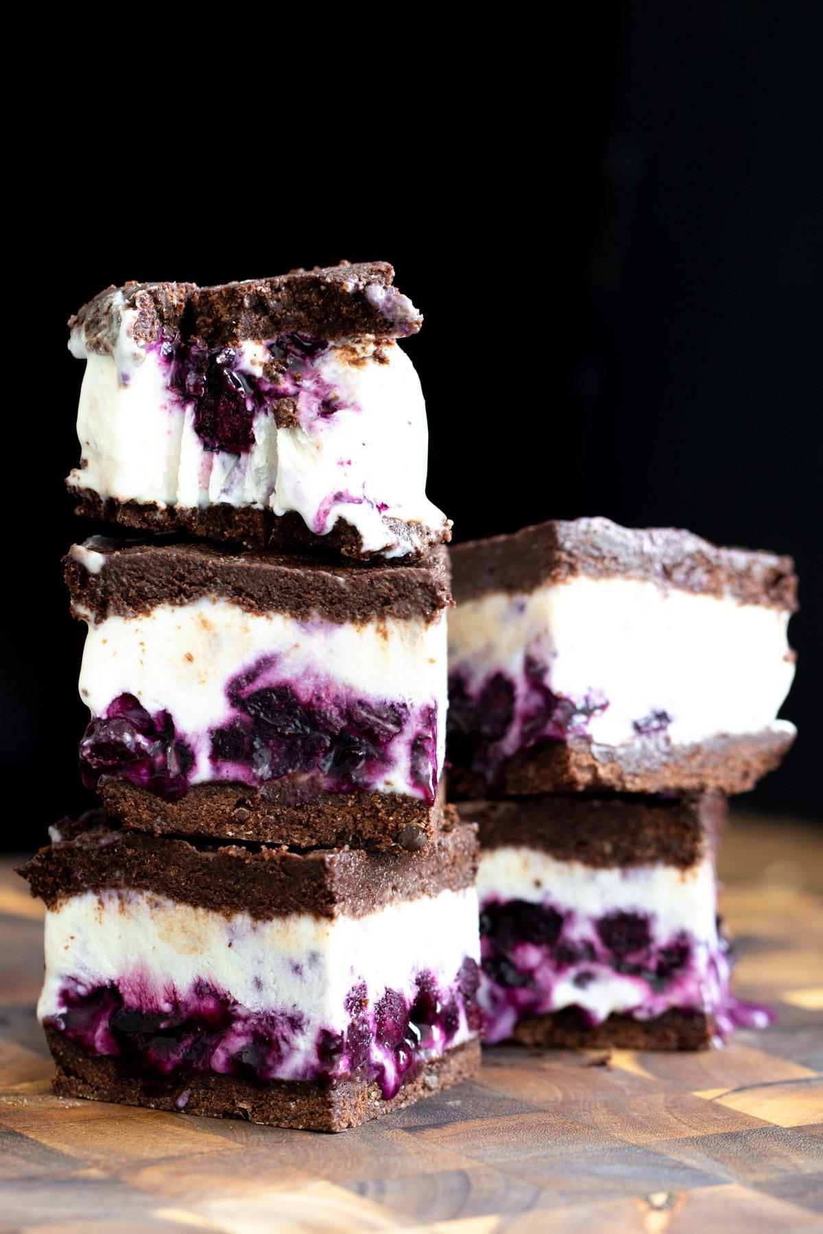 vegan chococolate vanilla ice cream sandwiches on a wooden board