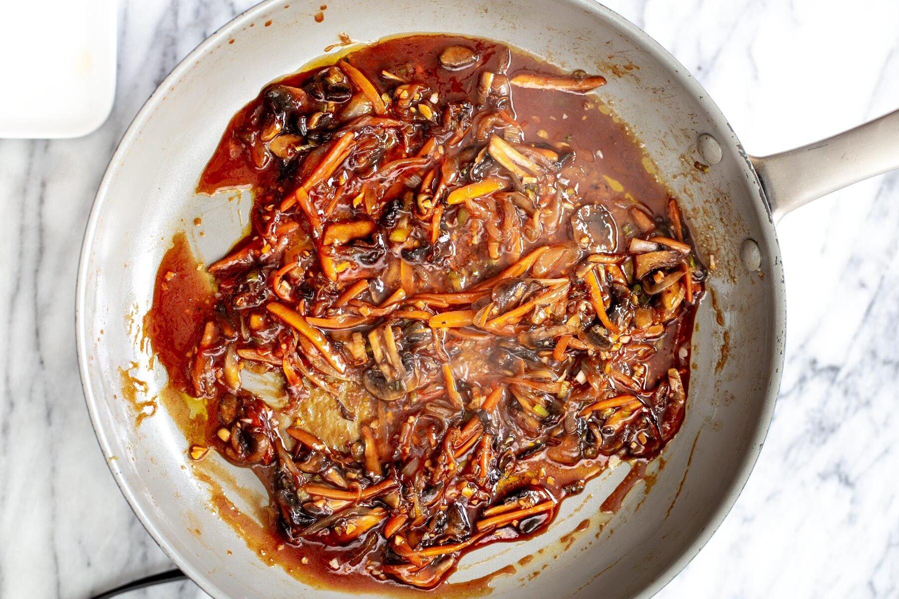 veggies in a saucepan simmering with sauce ingredients