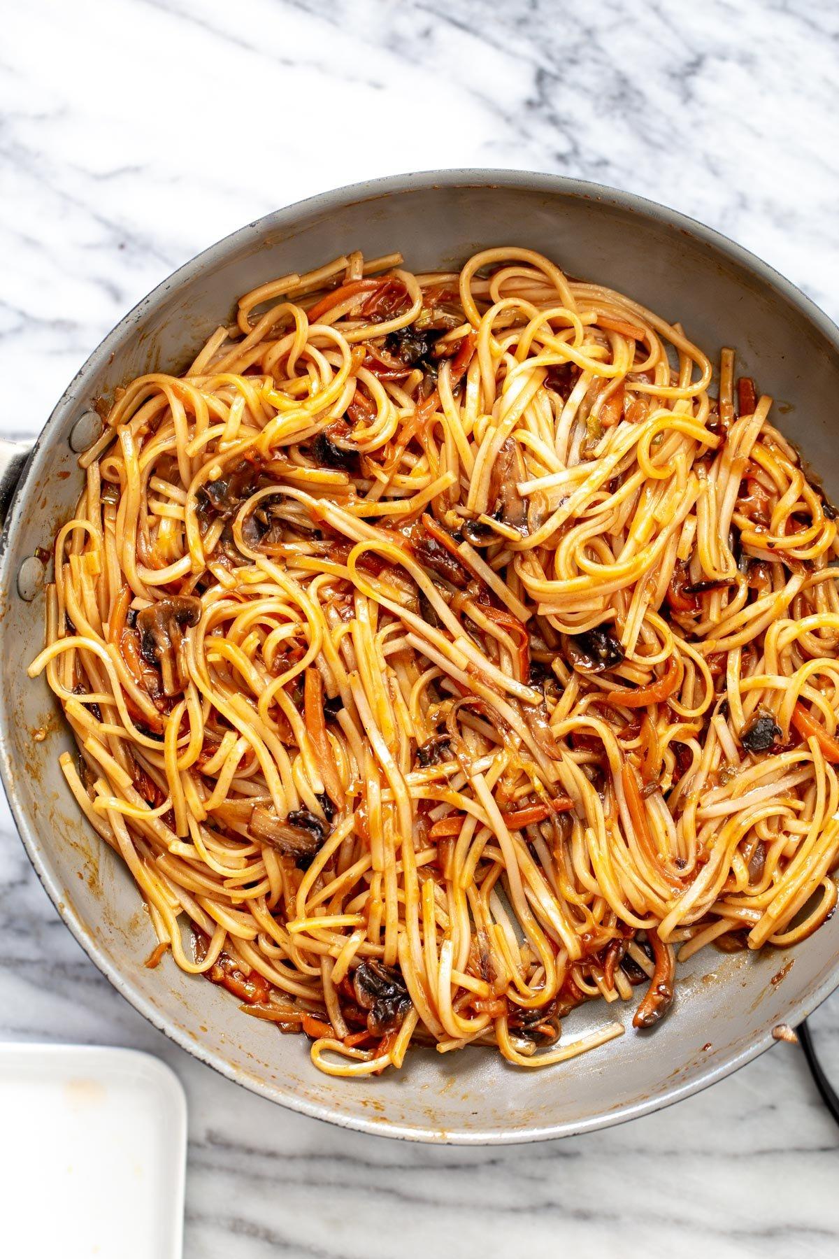 Vegan Korean gochujang noodles in a saucepan