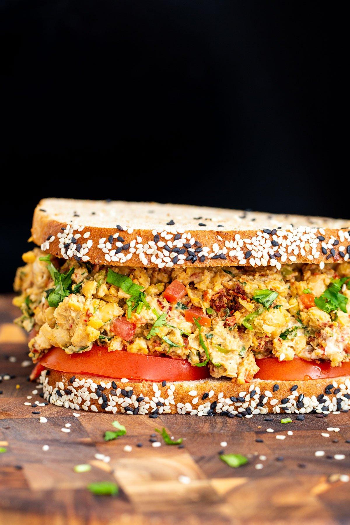 close up side view of vegan Mediterranean chickpea sandwich