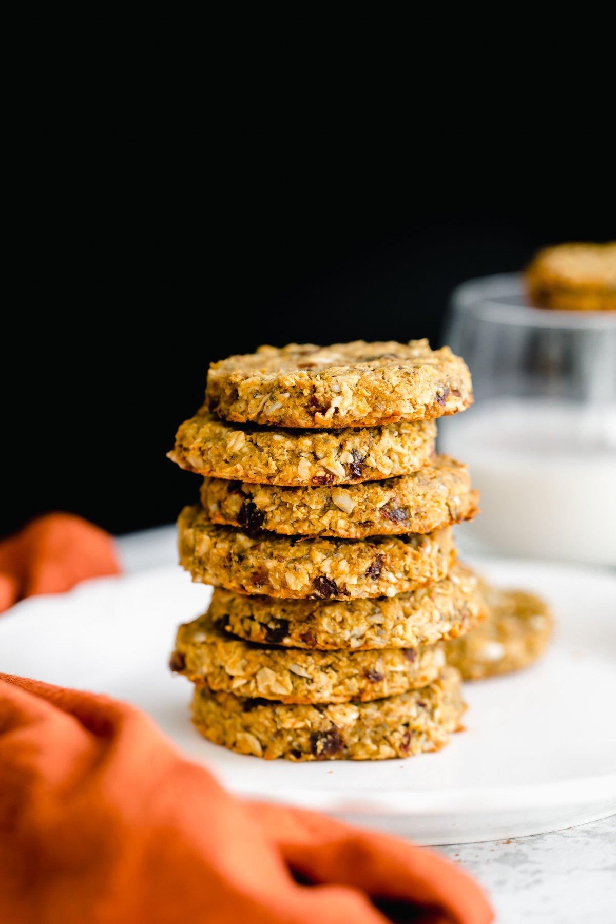 stacked vegan pumpkin breakfast cookies with nuts and seeds