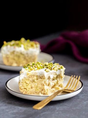 a slice of vegan ras malai tres leches cake