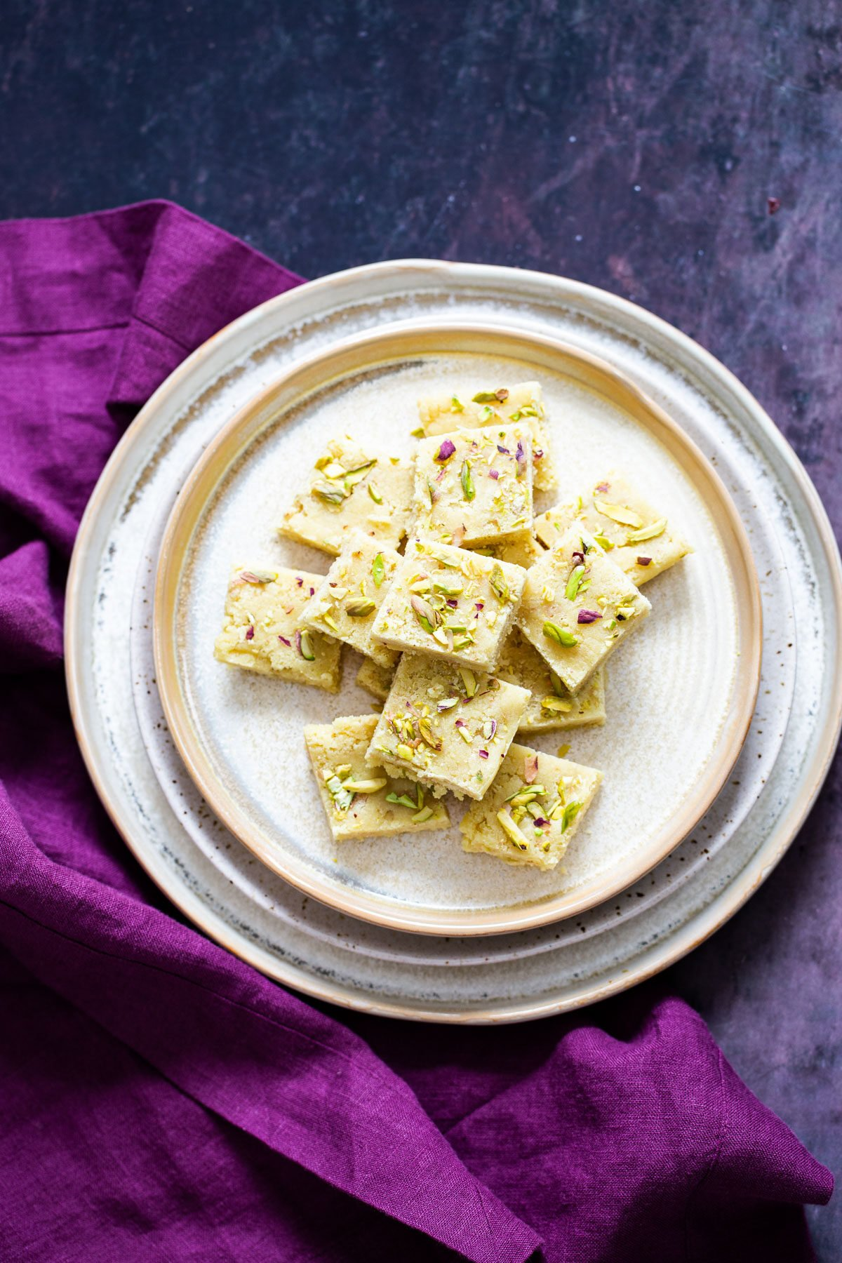 vegan almond burfi topped with pistachios and almonds