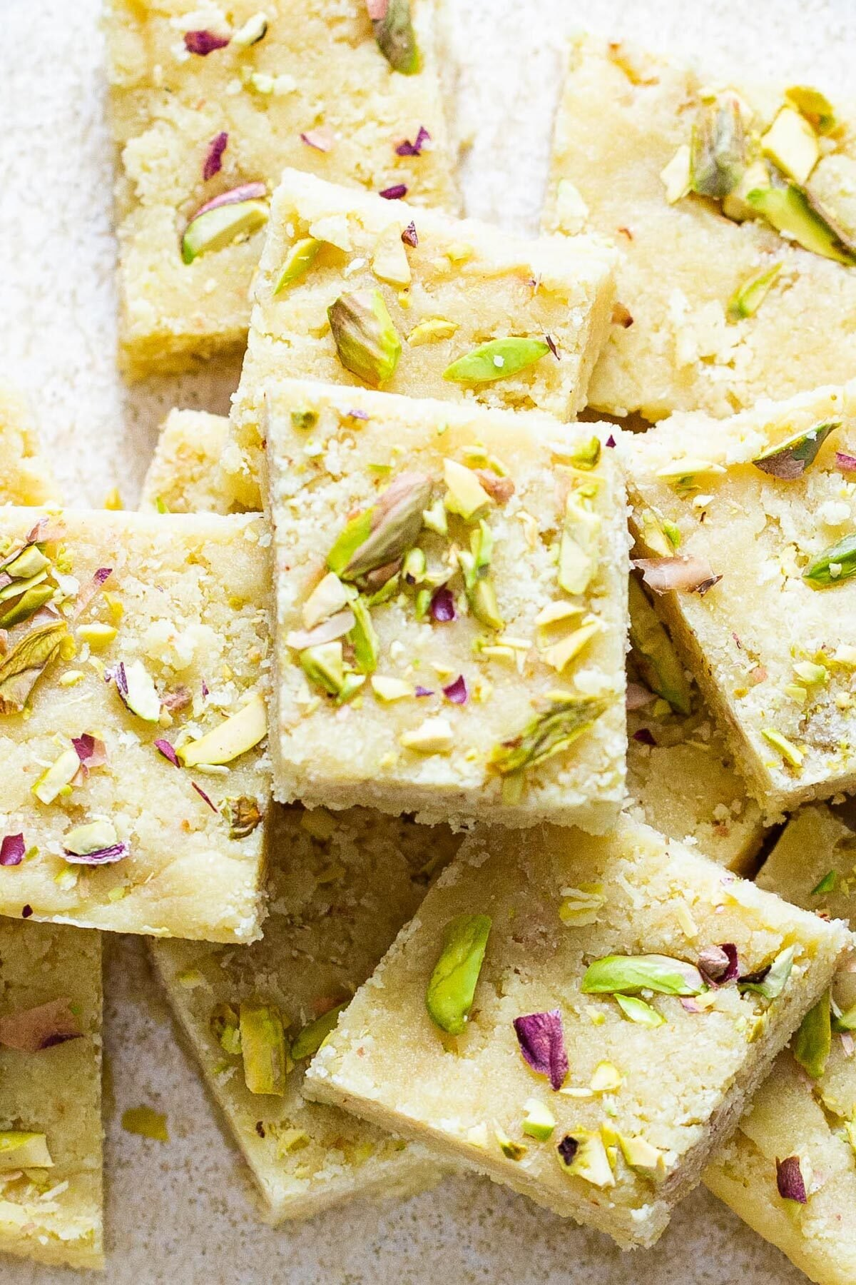 almond burfi topped with chopped nuts